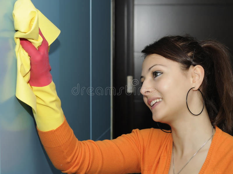 Download Smiling Women Worker Cleaning The House - Wardrobe Stock Images - Image: 11724084