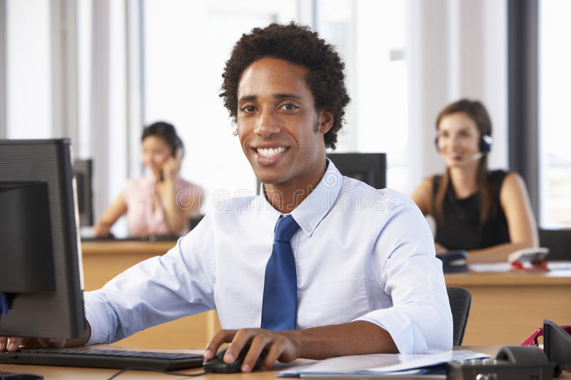 Smiling Worker In Busy Office royalty free stock photos