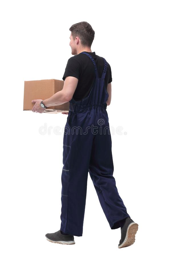 Smiling worker with cardboard box stepping forward. isolated on white royalty free stock photography