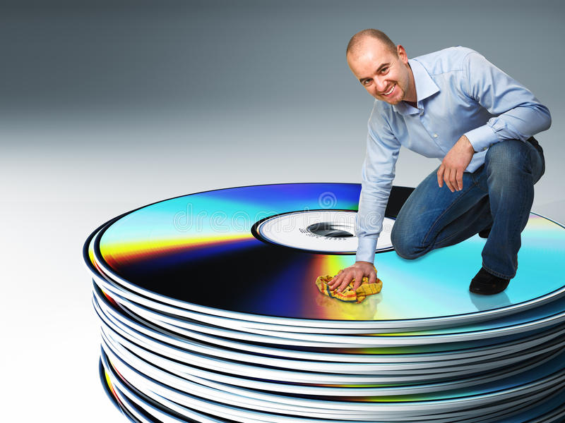 Smiling worker on cd royalty free stock photography