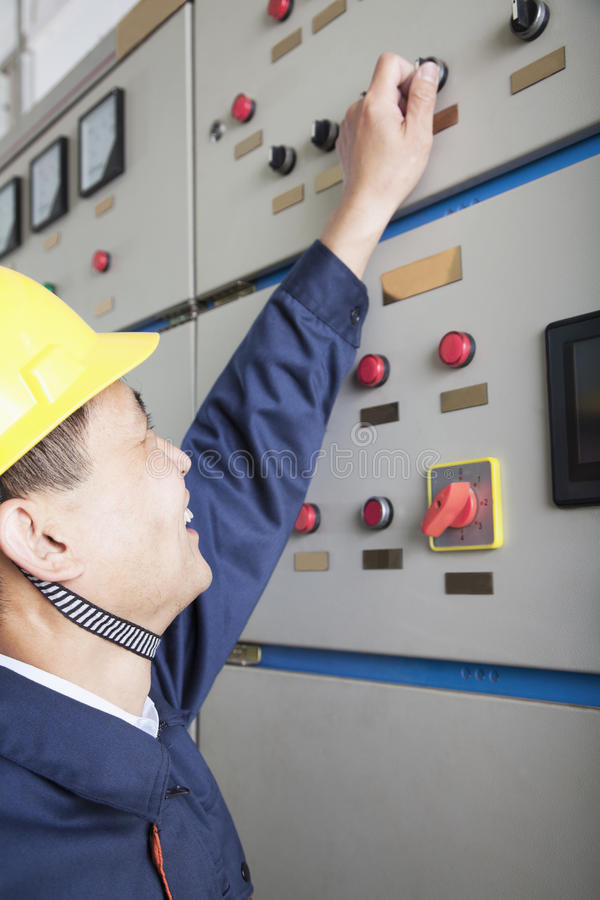 Smiling worker checking controls in a gas plant, Beijing, China stock photos