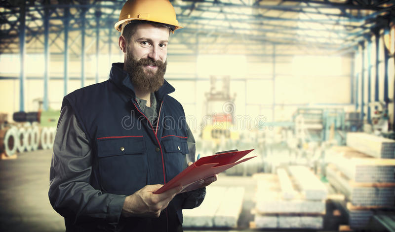 Smiling worker in protective uniform stock photo