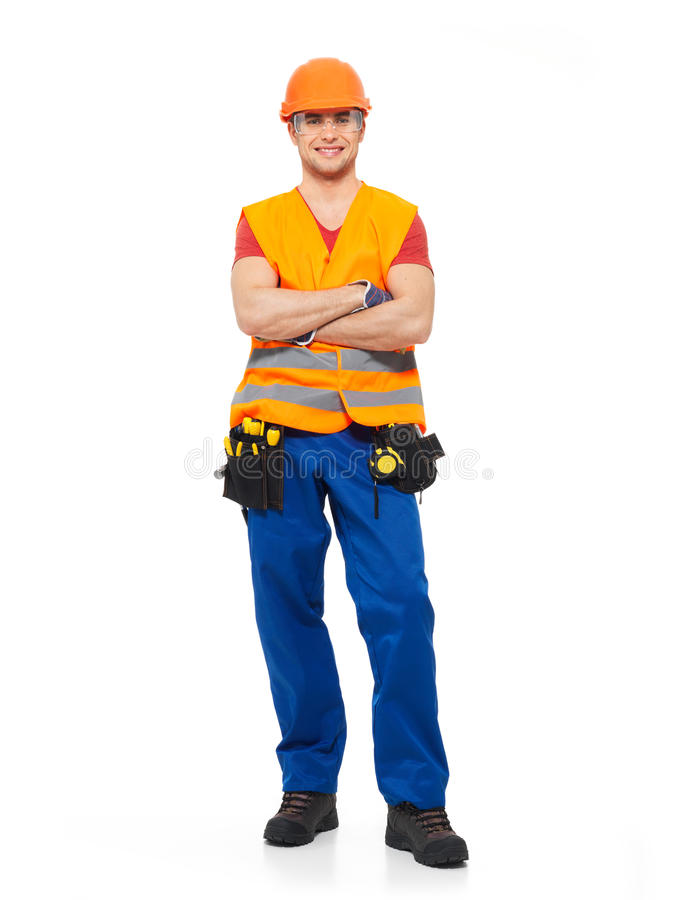 Smiling workman with tools in uniform stock image