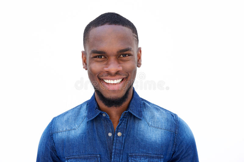 Smiling young african american man in a denim shirt royalty free stock image