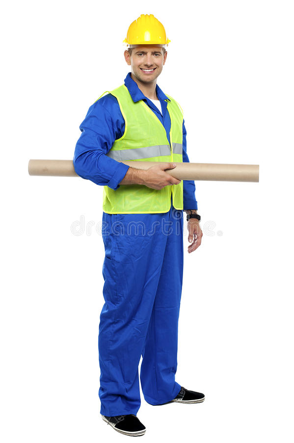 Download Smiling Young Architect Holding Blueprints Stock Photo - Image: 26683720