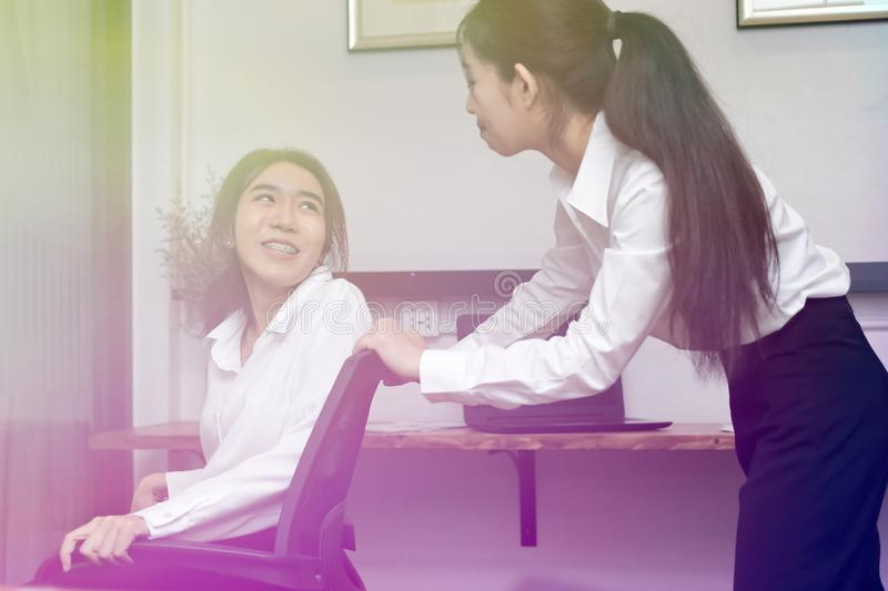 Smiling young Asian business female having fun in office royalty free stock photos