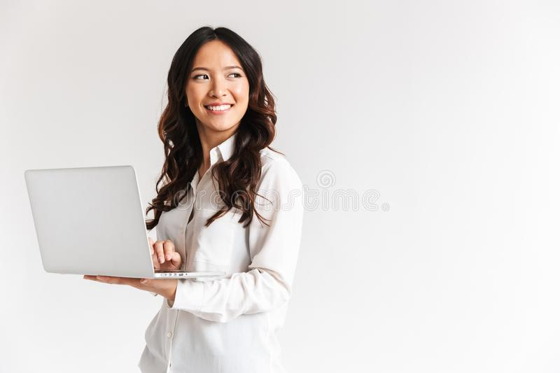 Smiling young asian businesswoman standing stock image