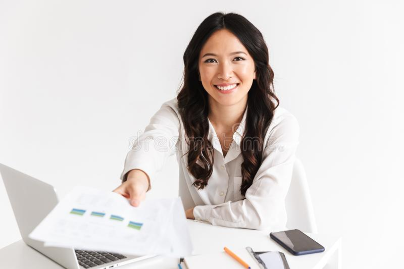 Smiling young asian woman giving paper graph stock photos