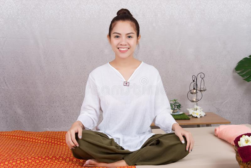 Smiling young Asian woman sitting waiting for preparing Thai sty royalty free stock photos