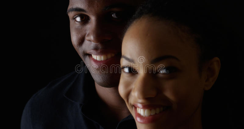 Smiling young black man and woman royalty free stock photo
