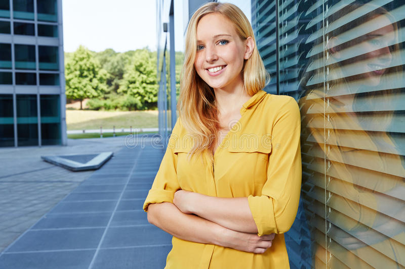 Smiling young blonde woman royalty free stock photos