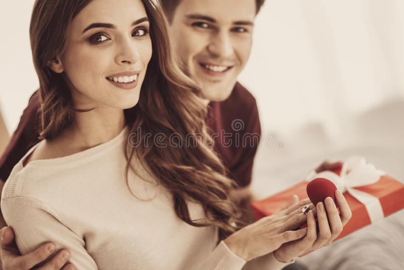 Smiling young bridegroom hugging his future beautiful wife stock images