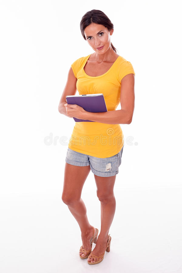 Smiling young brunette with a tablet pc royalty free stock photos