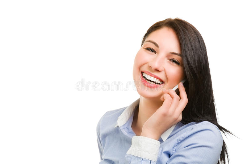 Smiling young brunette woman talking on the phone. Portrait of smiling young brunette woman talking on the phone stock photos