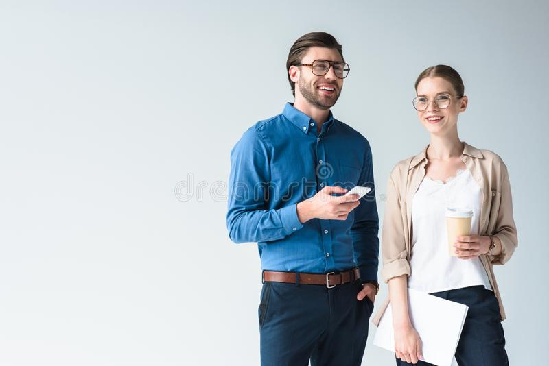 Smiling young business colleagues isolated. On white stock images