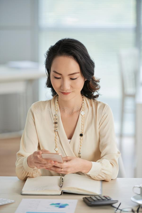 Texting young business lady stock photography