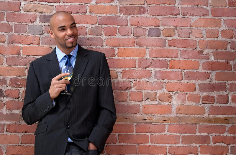 Download Smiling Young Business Man Drinking Wine Stock Photo - Image of glass, entrepreneur: 19943160
