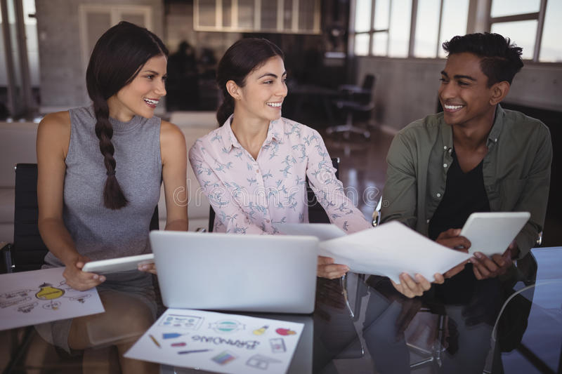 Smiling young business people working together at office stock photos