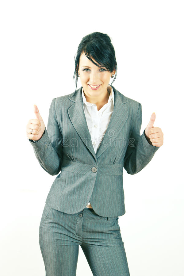 Smiling young business woman giving thumbs up