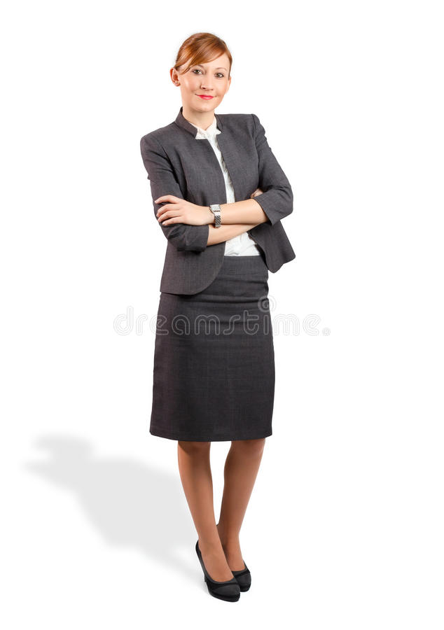 Smiling young business woman with hands crossed stock photo