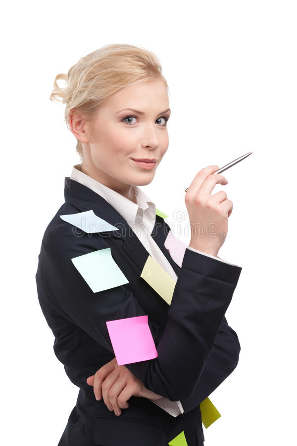 Smiling young business woman holding pen royalty free stock image