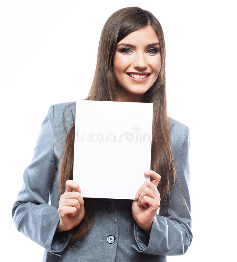 Smiling young business woman show blank signboard. Isolated on white background stock photography