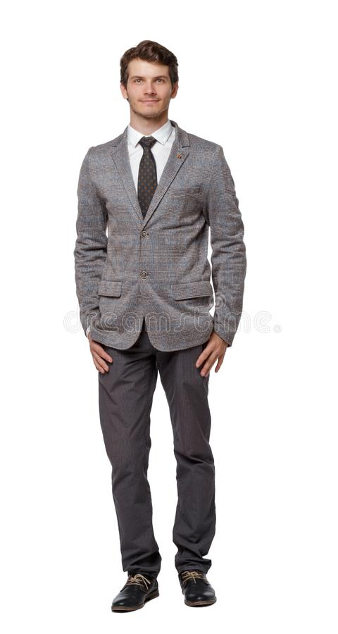 Smiling young businessman. Front view royalty free stock image