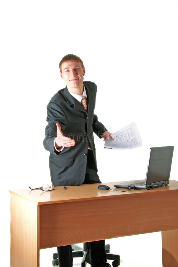 Download Smiling Young Businessman Greeting, Workplace Stock Image - Image: 12041343