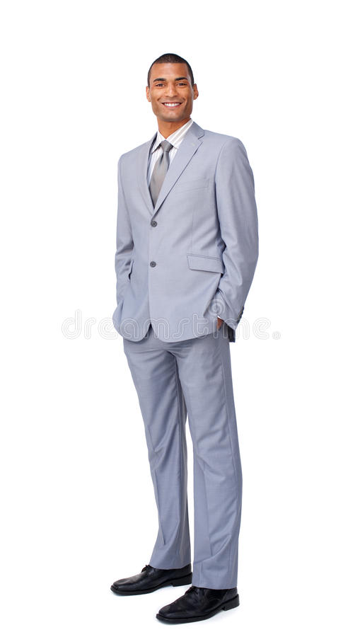 Smiling young businessman with hands in pockets stock photography