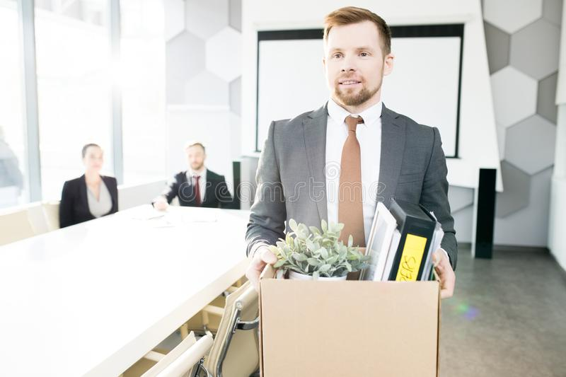 Smiling Young Businessman Quitting Job royalty free stock photo