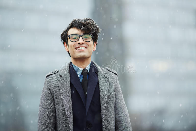 Smiling Young Businessman in Snow royalty free stock photo