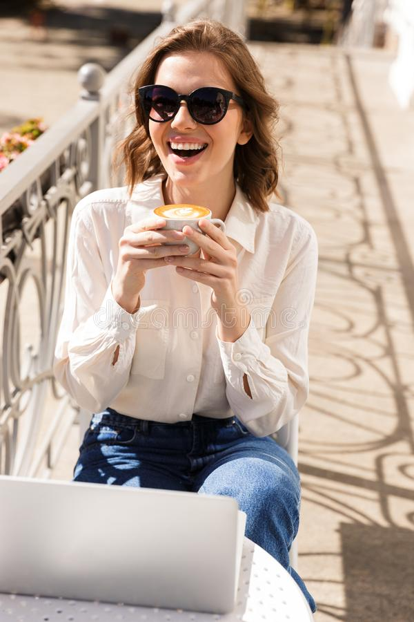 Smiling young businesswoman sitting at the cafe royalty free stock photos