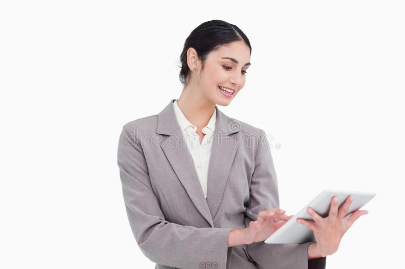 Download Smiling Young Businesswoman Using Tablet Computer Royalty Free Stock Image - Image: 23014116