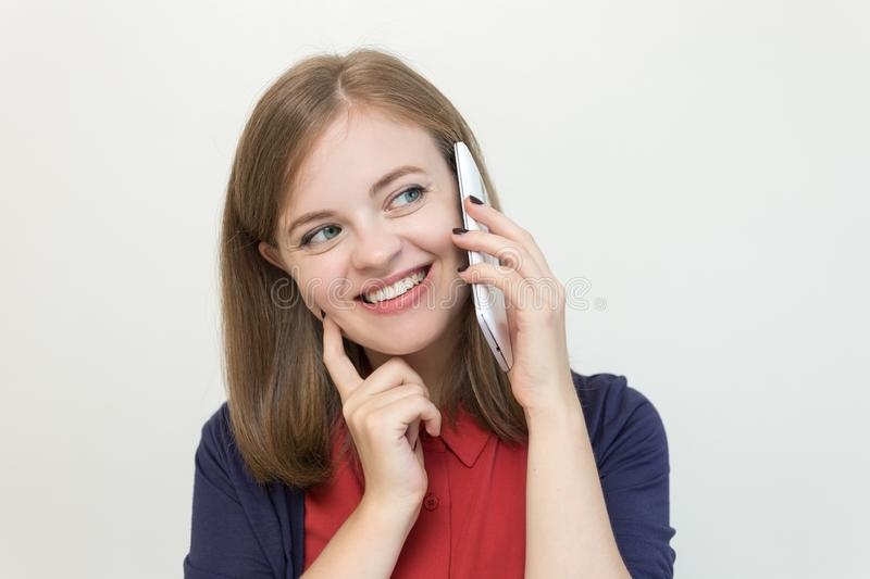 Smiling young caucasian girl woman hold talk on the mobile phone stock photography