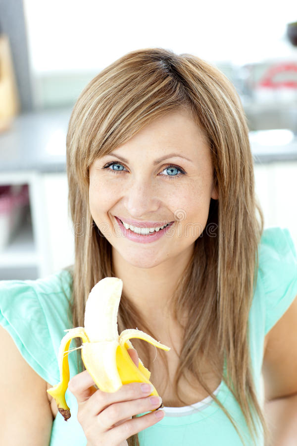Smiling Young Caucasian Woman Holding A Banana Stock Image