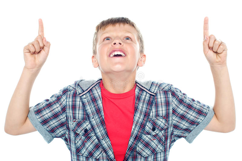 Smiling young child looking up and pointing stock photo