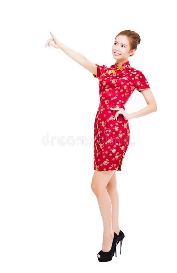 Smiling young chinese woman pointing something royalty free stock images