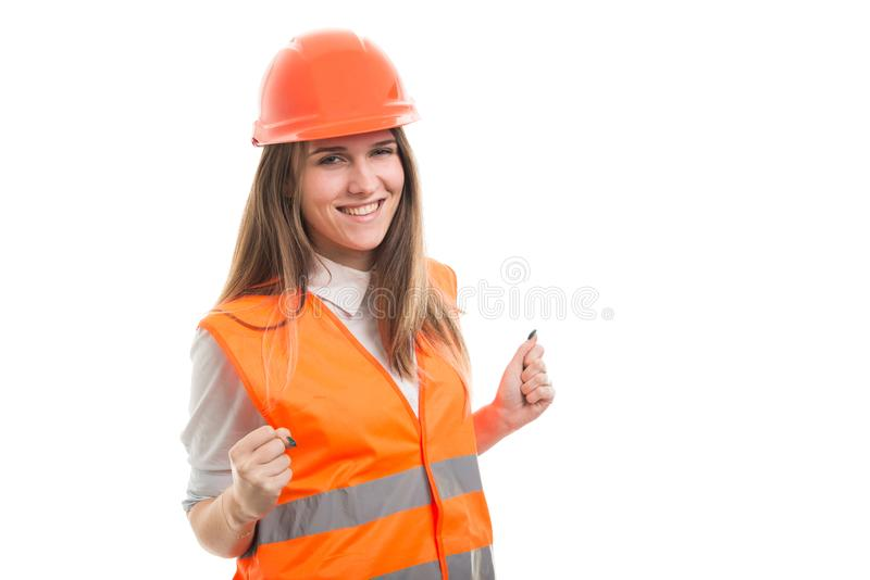 Smiling young construction woman enjoying her success stock images