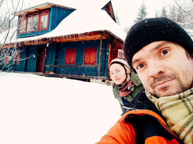 Smiling young couple having fun outdoors winter royalty free stock photos