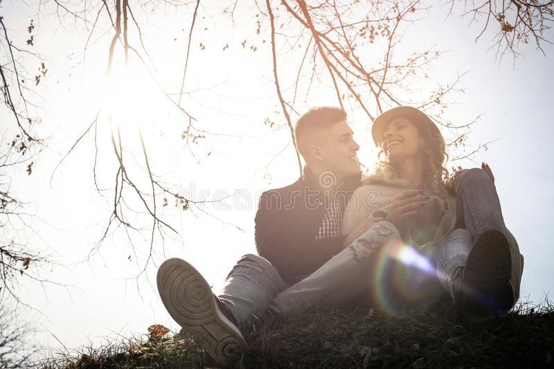 Young smiling couple in park. royalty free stock image
