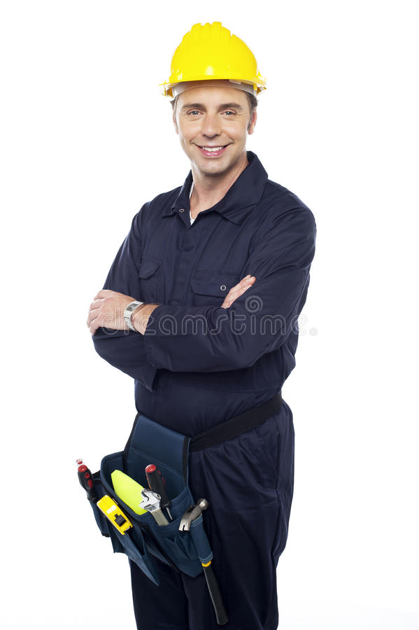 Smiling Young Craftsman With Tool Pouch Royalty Free Stock Photos