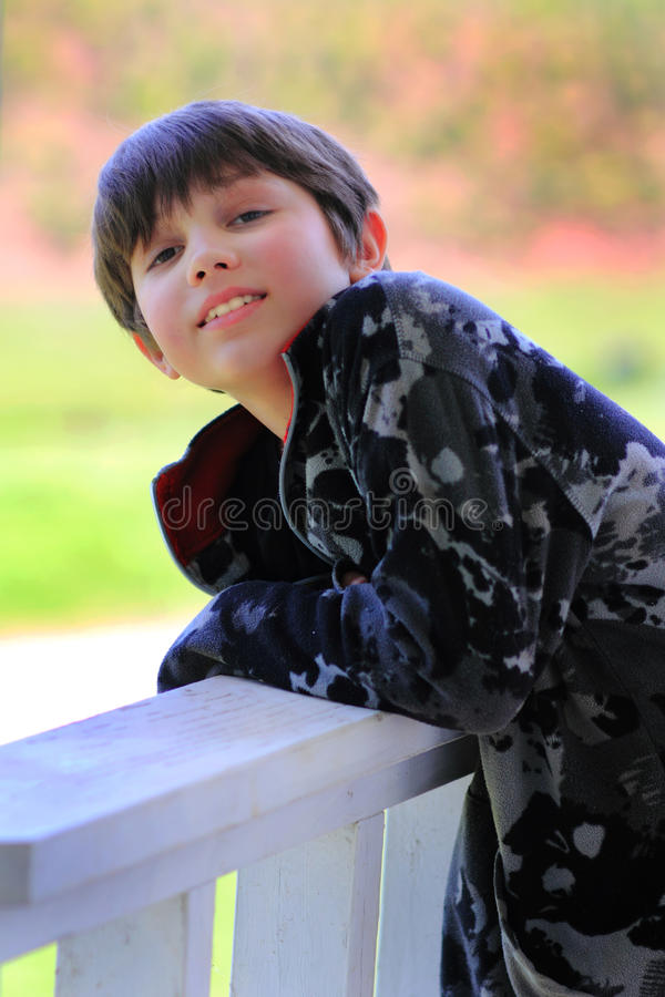 Smiling Young Dark Haired Boy stock photography