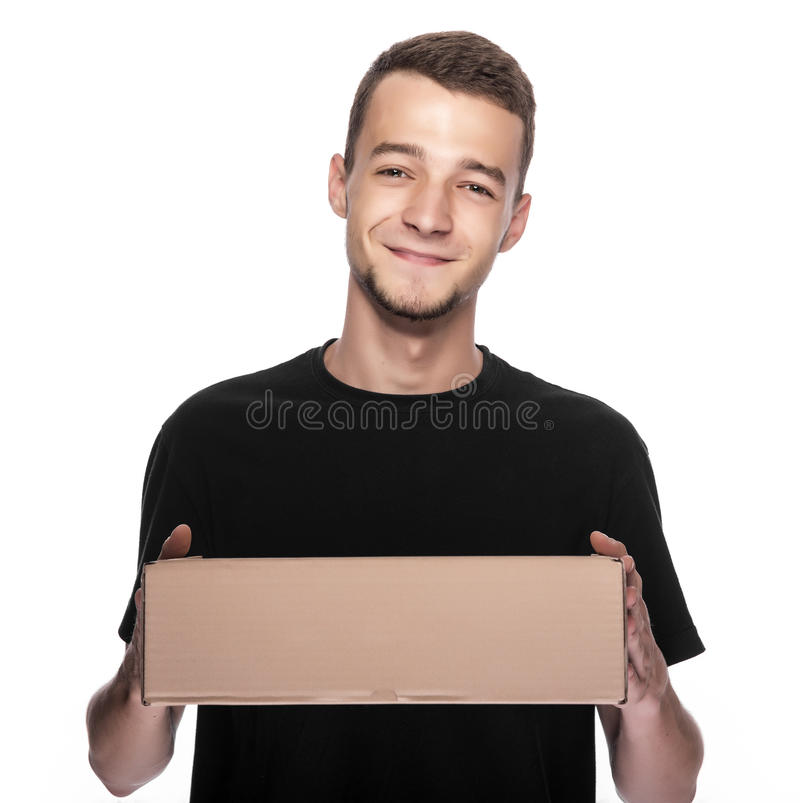 Smiling young delivery man. royalty free stock images