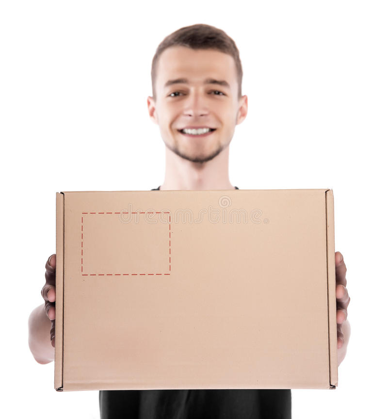 Smiling young delivery man. royalty free stock photography
