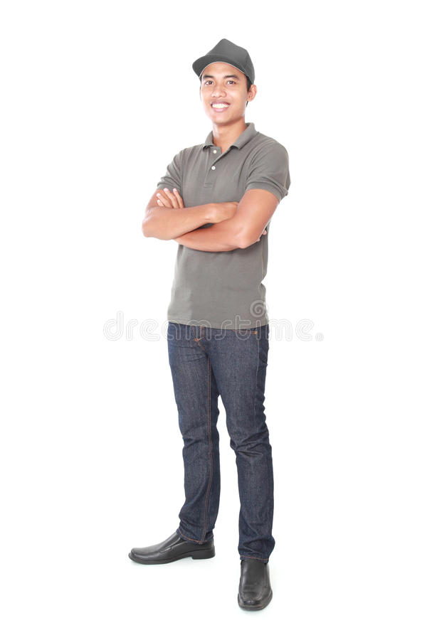 Smiling young delivery man royalty free stock images