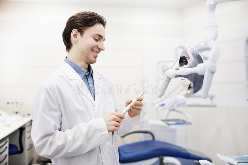 Smiling Young Dentist stock photography