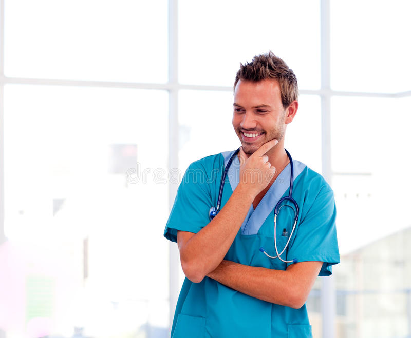 Download Smiling Young Doctor Isolated In Hospital Stock Photo - Image: 10067106
