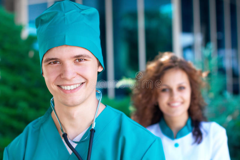 Smiling young doctor with a nurse royalty free stock photos