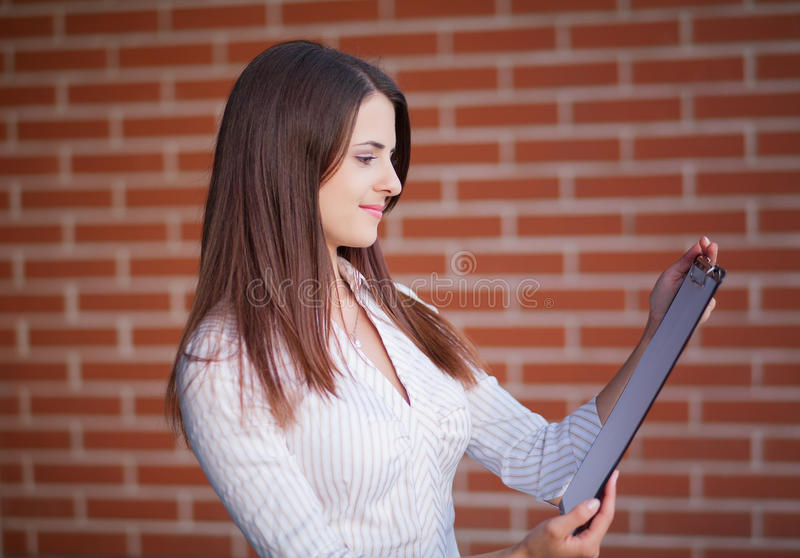 Smiling young elegant businesswoman royalty free stock photo