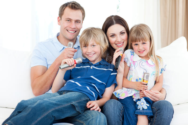 Download Smiling Young Family Singing A Karaoke Together Stock Image - Image: 12053971